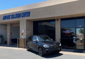 What should I look for when choosing a collision repair shop?